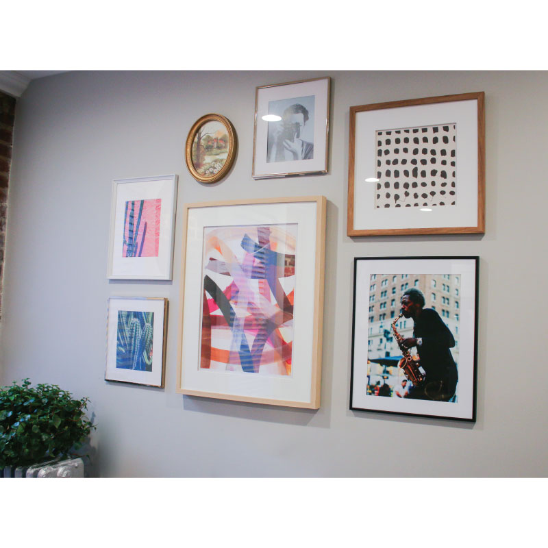 Eliana's living room gallery wall.