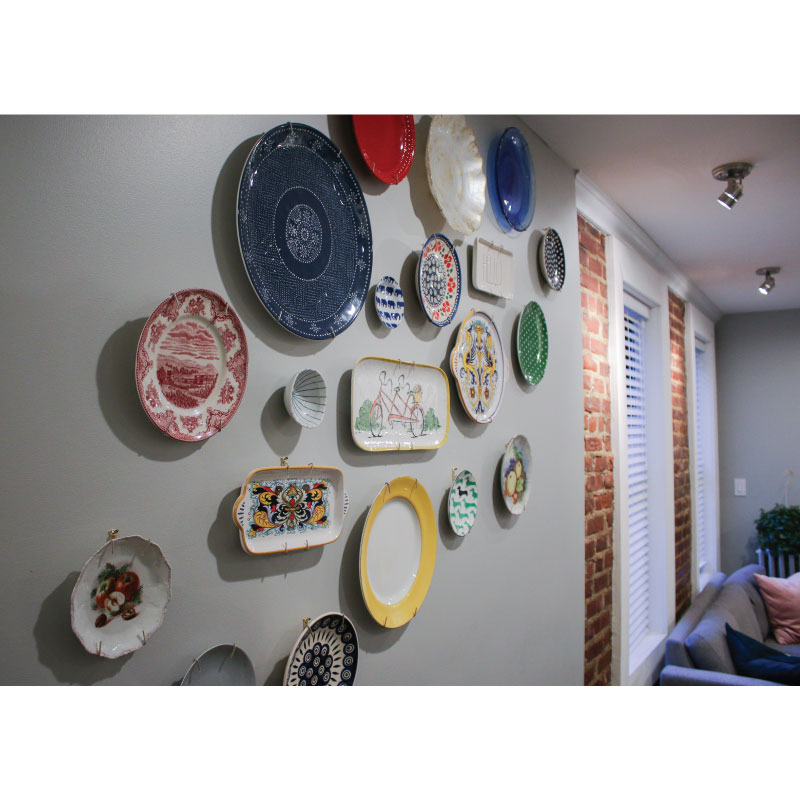 Eliana's wall of plates (designed in part by her dad).