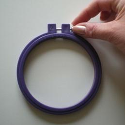 Using an embroidery hoop.
